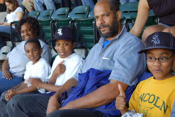 My family enjoying a day at the White Sox baseball game one summer. Black love starts at home!